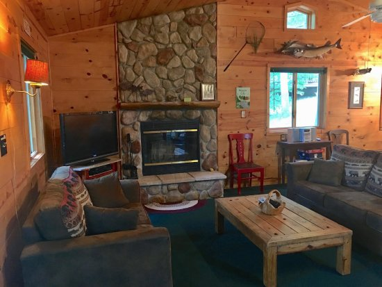 Lac du Flambeau, WI: River rock fireplace, knotty-pine interiors in The Marq