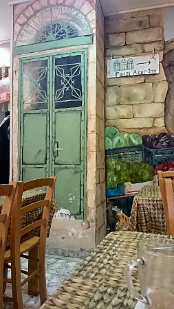 Fauzi Azar Inn by Abraham Hostels: A wall painting in dining room