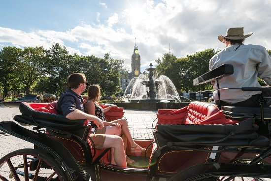 Quebec City, Canada: Horse-drawn carriage tour in front of Tourny Fountain and Parliament Building