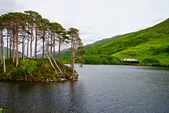 Perth, UK: Eilean Na Crac in Loch Eil with the Jacobite Steam Train