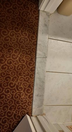El Portal, CA: bathroom tile cracked - moved when you walked on it