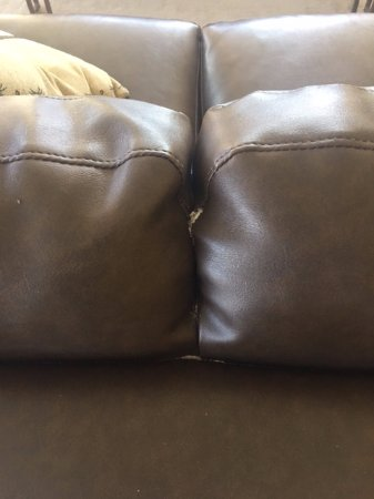 The Palm Bay Club: couch was split and shedding the stuffing