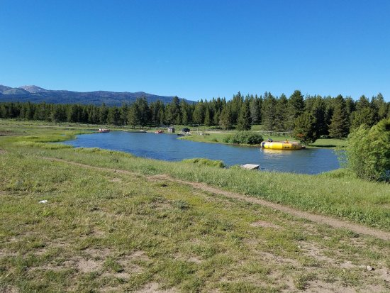 Island Park, ID: The swimming and boating pond with trampoline.