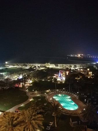 Night view of the hotel grounds and beach