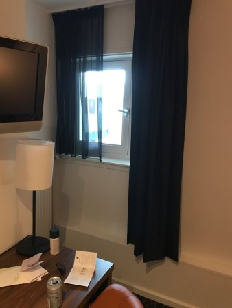 Hampshire Hotel - Eden Amsterdam: The smallest window in a hotel room I've ever seen, followed by a view of the inside of the buil