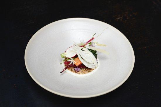 Bak restaurant: Starter in May messeklever cheese/ wild garlic (oil and flower)/ cracker with hempseed/ vegetabl