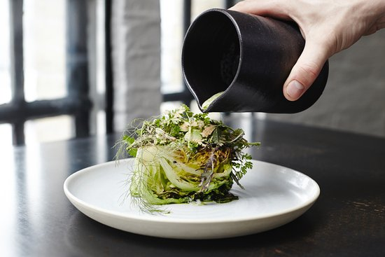 Bak restaurant: lettuce from the bbq/ oyster-sauerkraut-buttermilk sauce with lovage oil/ powder of botarga/ wil