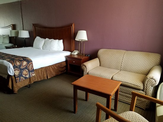 Raintree Inn: King bed with sofa.