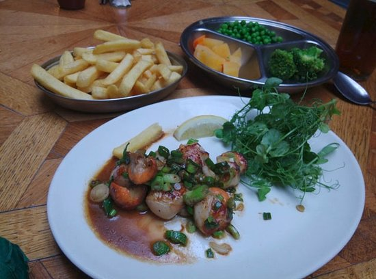 The Dolphin Hotel's 'signature' dish - pan-fried Lyme Bay scallops with vegetables and chips