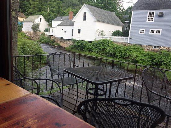 New Boston, NH: View of patio and river from one of the back tables.