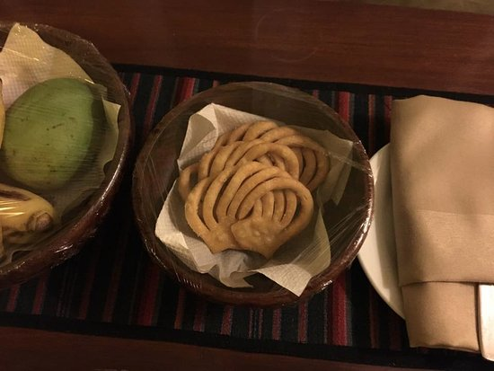 Shambaling Boutique Hotel : In-room welcome snacks. Fried bread and fruit.
