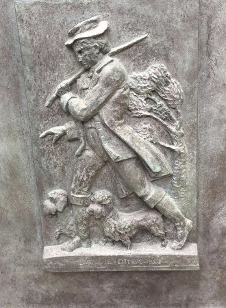Selkirk, UK: The Bass Relief on the side of the Old Ginger statue shows the Walter Scott character Dandie Din