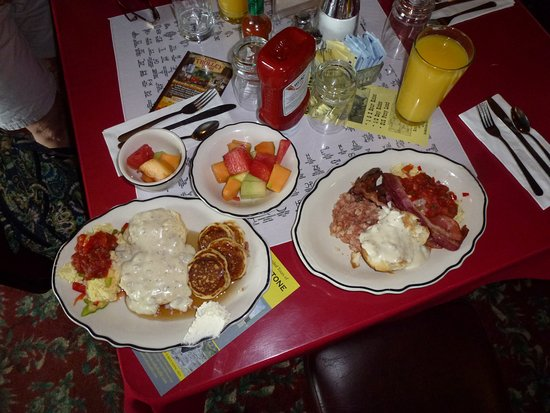 Irma Restaurant and Grille: A sample of some of the smorgasbord breakfast items. Orange juice is extra but tasted fresh
