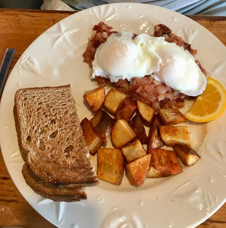 The Sailing Cow Cafe : Your basic two poached eggs over hash. :)