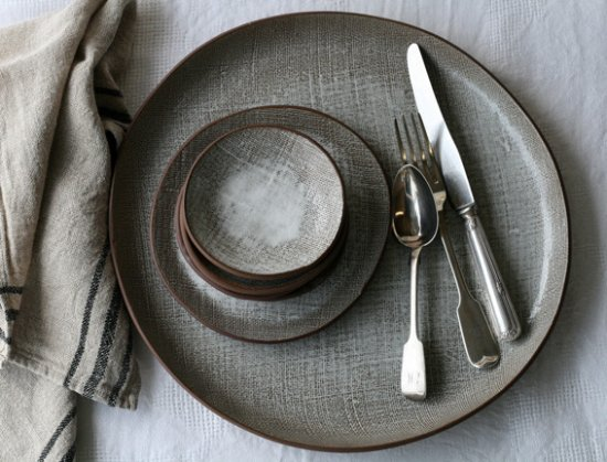 Waiheke Island, New Zealand: Bespoke Dinner Sets are our specialty. We texturize clay using burlap fabric.