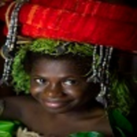 Young girl in traditional head dress in the Solomon Islands