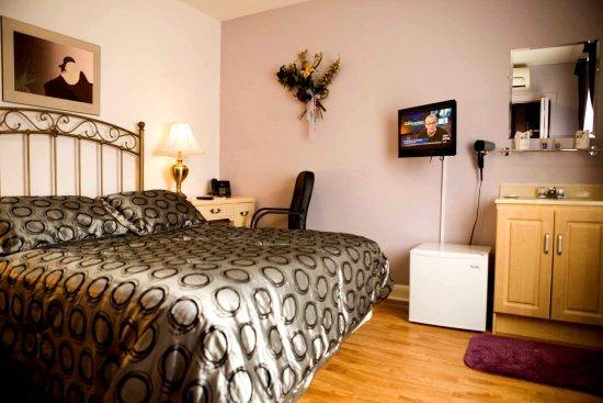 Auberge Maison Roy : chambre lit king pour les amoureux