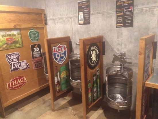 Brewport Brewing Company: Men's room with recycled kegs for urinals