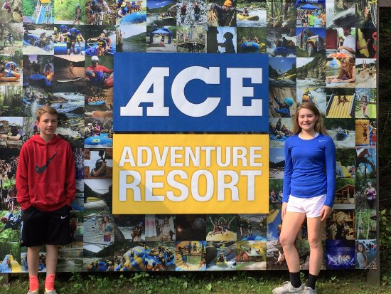 ACE Adventure Resort: My brother and I standing in front of the opening sign