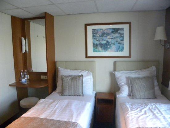 Literie confortable Photo de OnRiver Hotels MS
