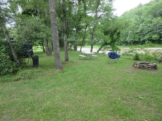Laurel Springs, NC: Fire ring, picnic table, and river.