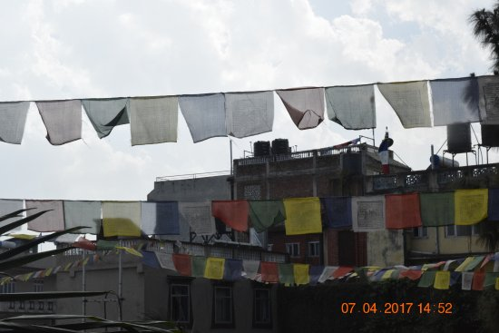 Hotel Tibet International: Prayer flags over the courtyard.