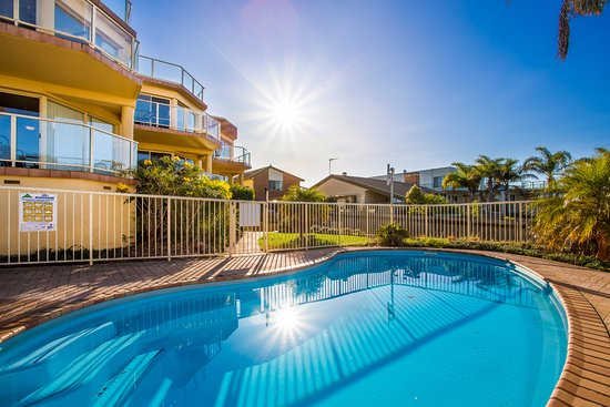 Baywatch Luxury Apartments Sunrise Over Pool Area With Deck Chairs Not