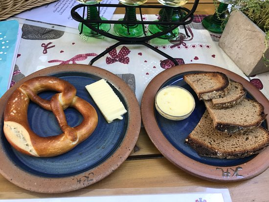 Weingut Karl Heidrich: We must have food with our wine! Pretzel with butter and Bread with garlic butte