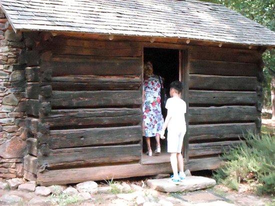 Stately Oaks Plantation: entering the log kitchen of the plantation