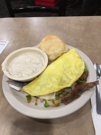Griddle Cafe & Deli: Philly cheese steak omelette with a side of gravy.