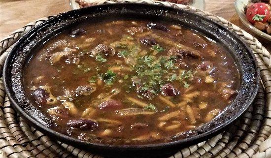 Troy, NY: Lamb w/ pomegranate, molasses, black olives, almonds and harissa.