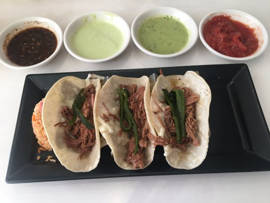 Brisket tacos with rice. Sauces: roasted tomato (chipotle ...