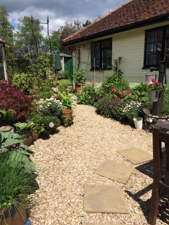 As The Annexe is at the back of the cottage you enter through the garden.