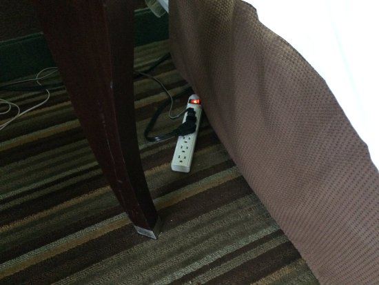 Deltona, FL: This power strip was laying under the bed skirt, Fire hazard! Should be mounted to wall.