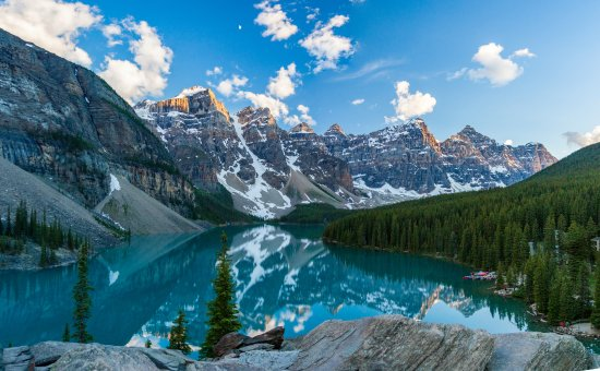 Moraine Lake Lodge: View of the lake, with hotel grounds/canoes on the right