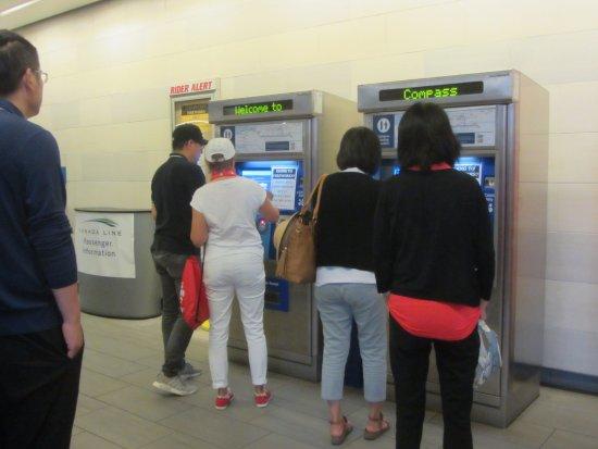 Tourism Vancouver Visitor Centre: Vancouver tourism Volunteer helping at Oakridge station