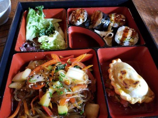 Westmount, Canada: Bento box with Asian salad, sushi sauteed vegetables and a beef empanadita.