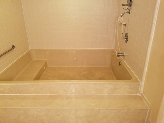 1800 Atlantic Suites: Master bathroom jacuzzi/shower/medical bill.