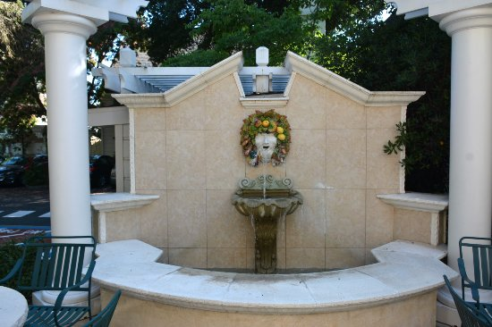 The Bergson: A ceramic sculpture of Bacchus presides over the patio fountain outside the breakfast room.