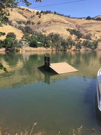 Piedra, CA: Restroom submerged in water.