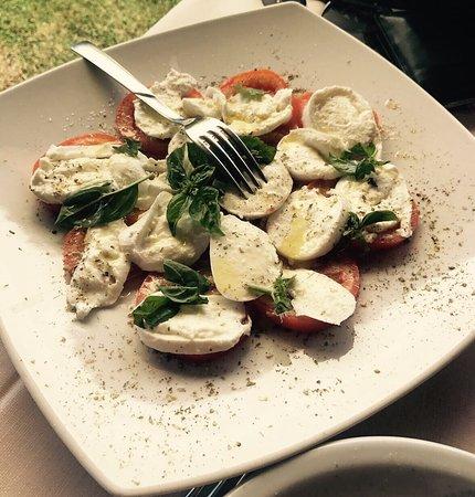 Villa San Pietro, Italia: Delicious lunch stop with local Sardinian food; buffalo mozzarella and tomato salad with charcut