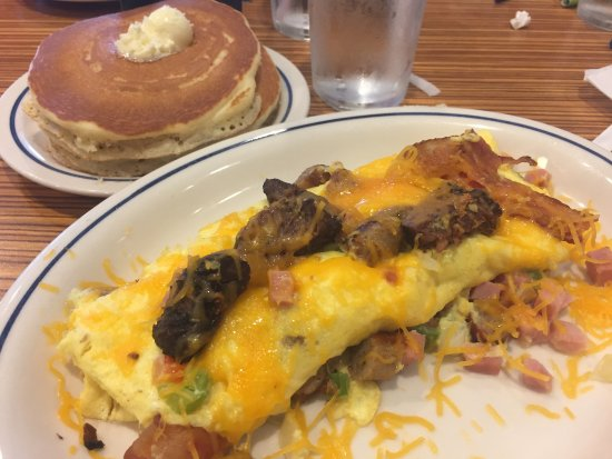 IHOP: Western omelette with ham, onion, peppers, cheese, bacon and steak. Yummy!