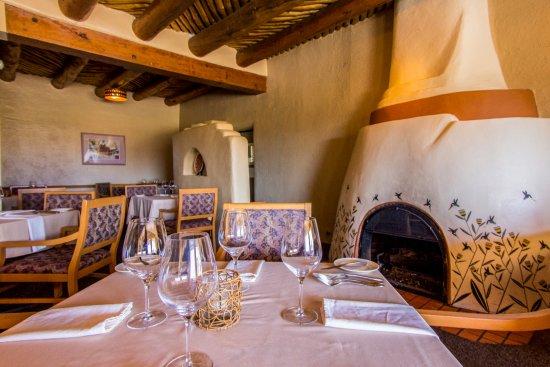 Prairie Star Restaurant & Wine Bar: Original kiva fireplace hand painted with ancient Anasazi pattern by renowned artist Robert Rive