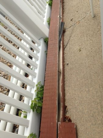 Wood decking w nail upright on ext pool patio. Dangerous!