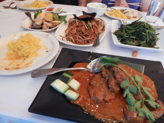Dublin, CA: Rendang Beef (bottom), and Hainan Chicken, Chow Koay Teow, and Belachan Kangkung (top).