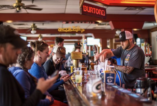 Garfinkel's: Make friends with locals and visitors. You never know who you'll sit next to at our bar.