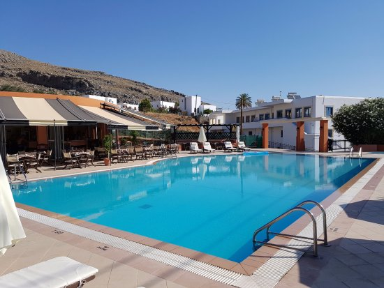 Romanza Studios: Waterside pool with studios in the background