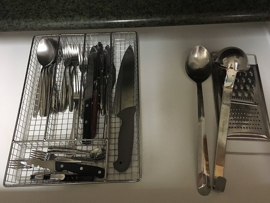 Aparthotel Santiago Building : Kitchen utensils and crockery in two bedroom apartment.