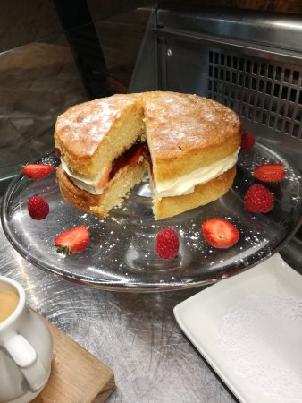 Denbigh, UK: Fancy a brew in the warm weather?, why not add a slice of our strawberry Victoria sponge aswell