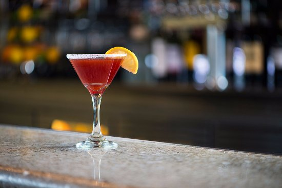 10 Below Restaurant & Lounge: the oxford - taaka vodka, fresh lemon, pomegranate juice, champagne float, sugar rim